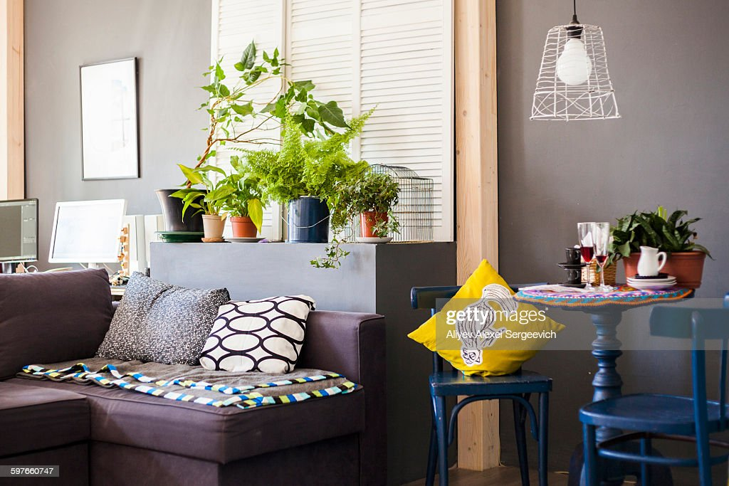 Empty room interior with sofa and small table with two chairs : Photo