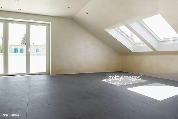 Empty room tiles floor door dormer window