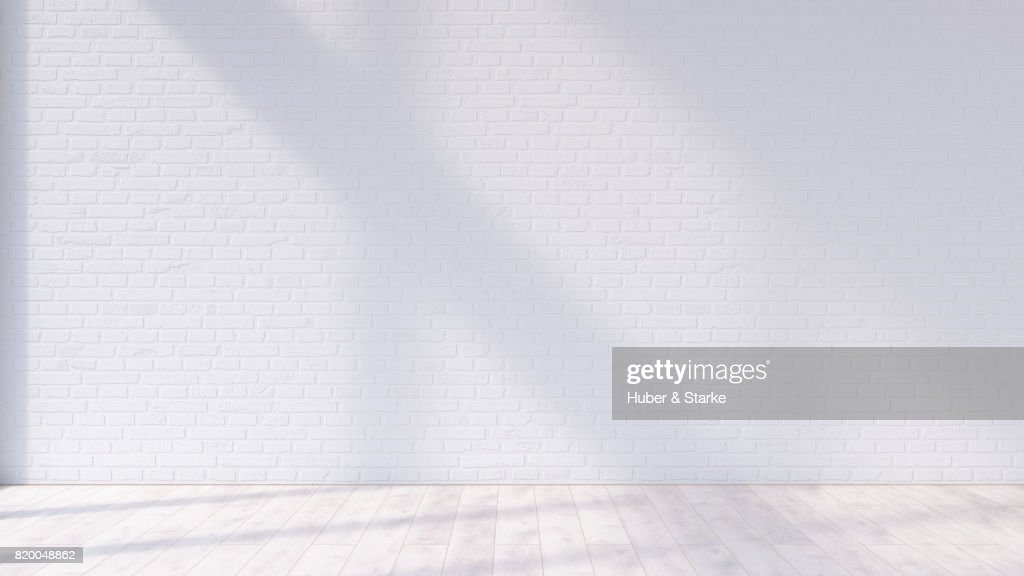 empty room with brick wall and hardwood floor : Stock Photo