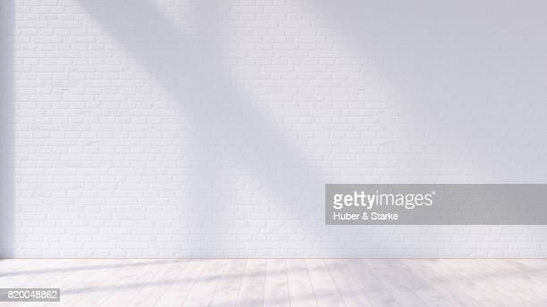 empty room with brick wall and hardwood floor - domestic room stock pictures, royalty-free photos & images