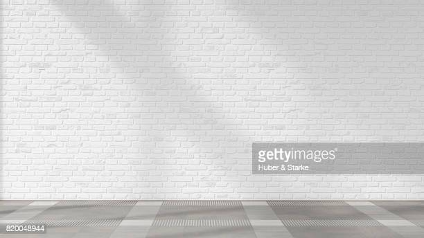 empty room with brick wall and tiled floor d