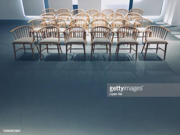 empty room with chairs - liyao xie stock pictures, royalty-free photos & images