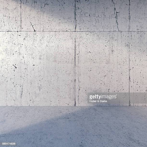 Empty room with concrete wall and floor