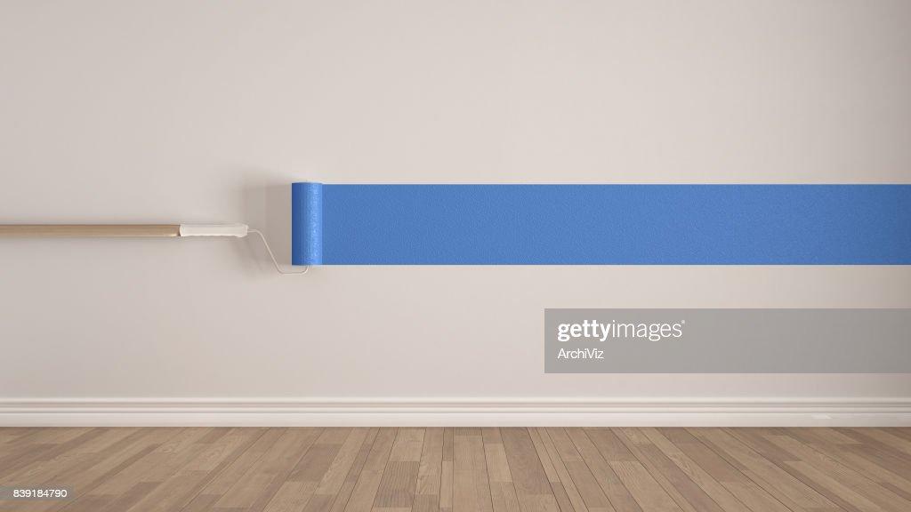 Lege ruimte met de verfroller en geschilderde muur houten vloer