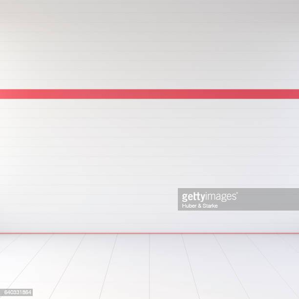 empty room with white tiles an one red stripe