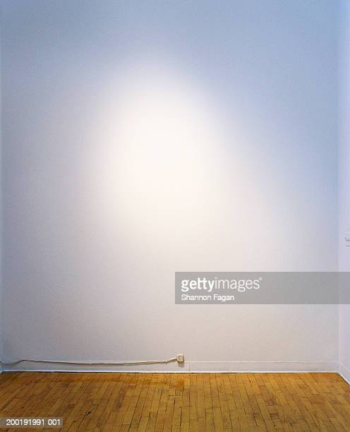 Empty room with wire running along baseboard
