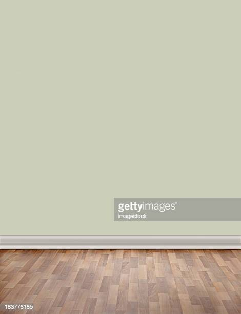 Empty room with wooden floor and green wall