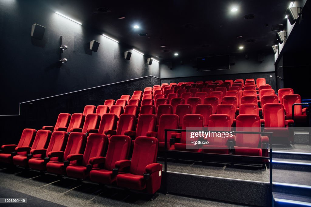 Empty rows of red seats : Stock Photo