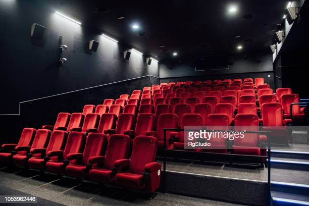 empty rows of red seats - film industry stock pictures, royalty-free photos & images