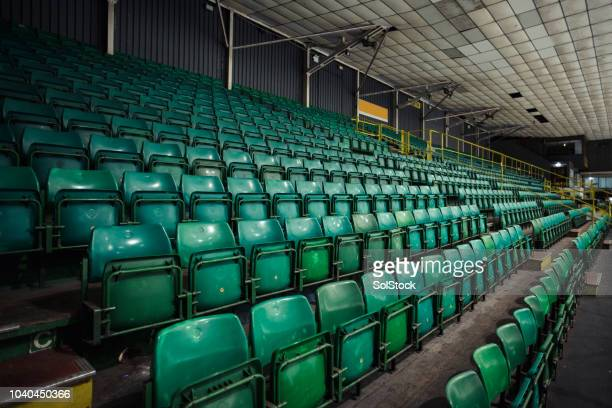 empty rows of seats in an ice rink - seat stock pictures, royalty-free photos & images
