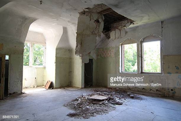 empty run-down room with hole in ceiling - ceiling stock pictures, royalty-free photos & images