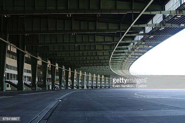 Empty Runway Against Roof At Airport