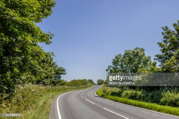 empty rural road in countryside - road stock pictures, royalty-free photos & images