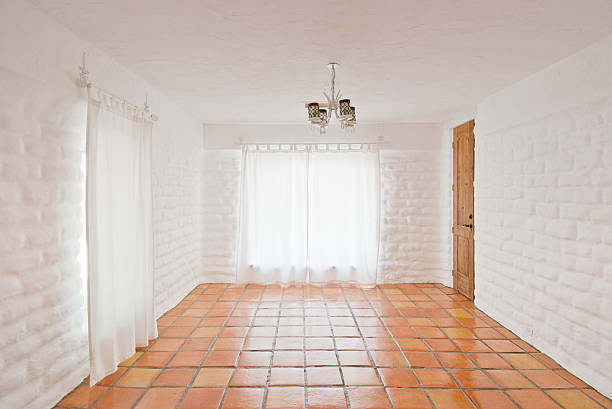 Empty Rustic Room With White Adobe Brick Wall And Tiles