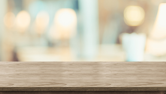 Empty rustic wood table and blurred soft light table in restaurant with bokeh background. product display template.Business presentation. 1022238030