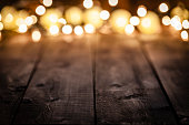 https://www.istockphoto.com/photo/empty-rustic-wooden-table-with-blurred-christmas-lights-at-background-gm1041796884-278914829