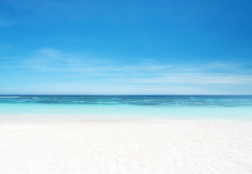 Empty sandy beach and sea with clear sky background 1153964825
