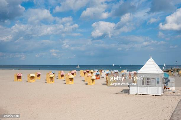 empty sandy beach with beach chairs, travemuende, baltic sea, schleswig-holstein, germany - schleswig holstein stock pictures, royalty-free photos & images