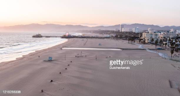 empty santa monica beach during covid-19 pandemic - city of los angeles stock pictures, royalty-free photos & images