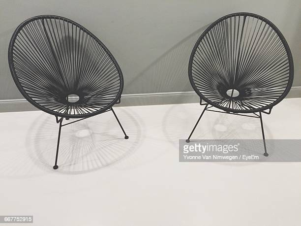 Empty Saucer Chairs By Wall At Home