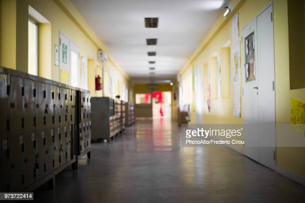 empty school corridor - education stock-fotos und bilder