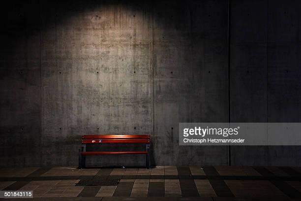 Empty seat on street at night