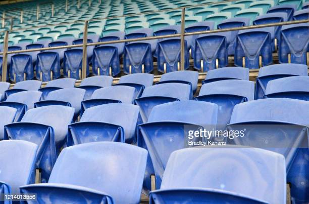 Empty seating is seen as crowds are locked out of the stadium due to the COVID-19 Coronavirus outbreak during the round 2 NRL match between the Gold...
