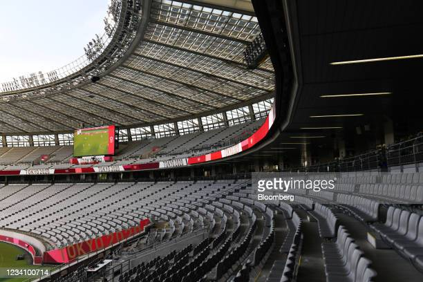Empty seating lines the stadium during an opening round women's football match between the U.S. And Sweden at the Tokyo 2020 Olympic Games in Tokyo,...