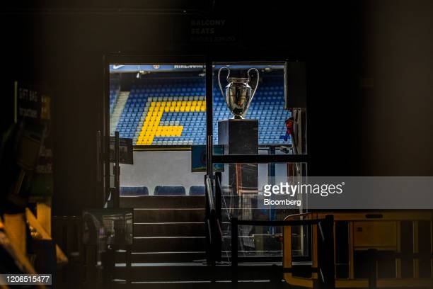 Empty seats and a trophy sit inside the Camp Nou stadium home to FC Barcelona in Barcelona Spain on Tuesday March 10 2020 Spains economy is...