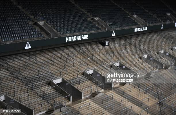Empty seats and stands at Borussia-Park football stadium are pictured on March 10, 2020 in Mönchengladbach. - Rhine Bundesliga derby between Borussia...