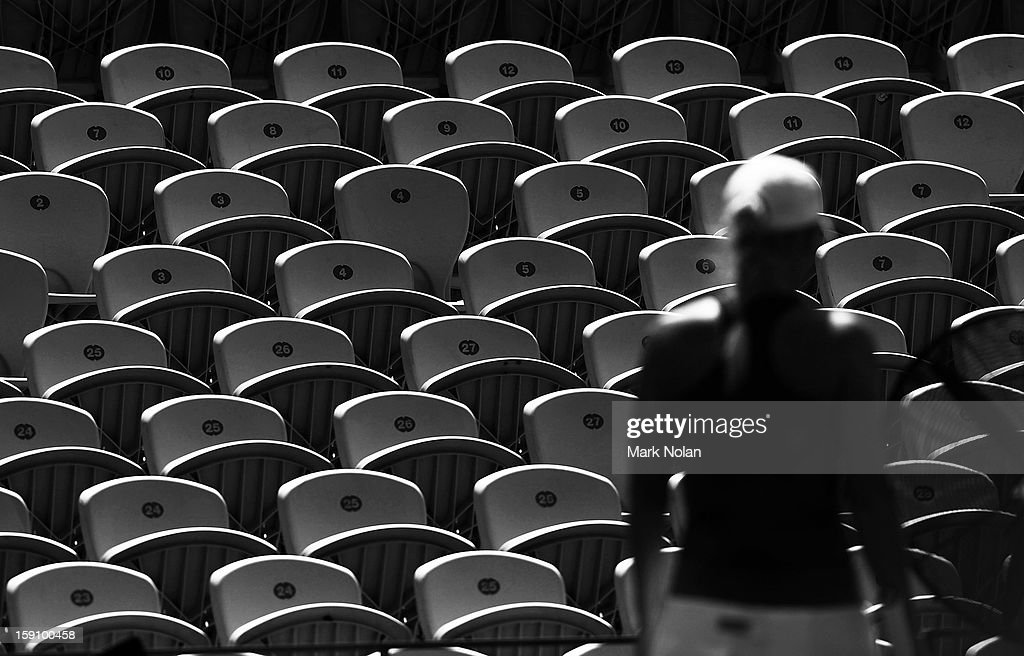 Empty seats are pictured due to the heat as Caroline Wozniacki of Denmark walks from the court in her second round match against Svetlana Kuznetsova of Russia during day three of Sydney International at Sydney Olympic Park Tennis Centre on January 8, 2013 in Sydney, Australia.