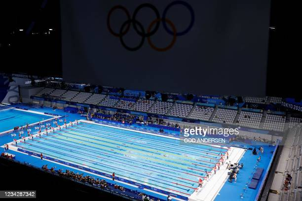 Empty seats are pictured during a heat for the women's 800m freestyle swimming event during the Tokyo 2020 Olympic Games at the Tokyo Aquatics Centre...