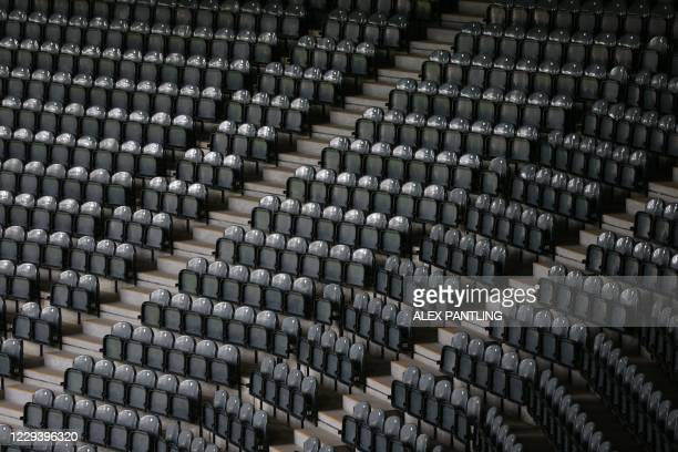 Empty seats are pictured in the stands ahead of the English Premier League football match between Newcastle United and Everton at St James' Park in...