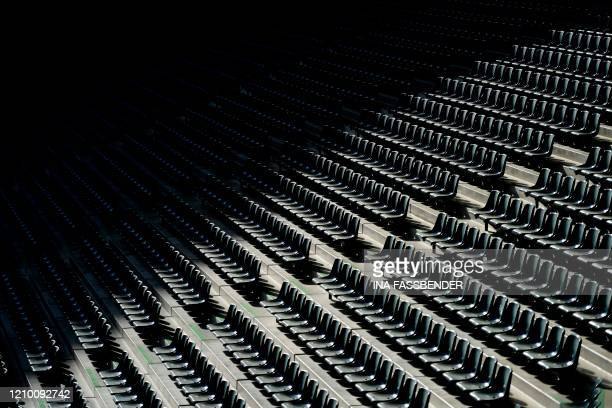 Empty seats are seen at the Borussia Park football stadium in Moenchengladbach, western Germany, on April 16 amid the novel coronavirus COVID-19...