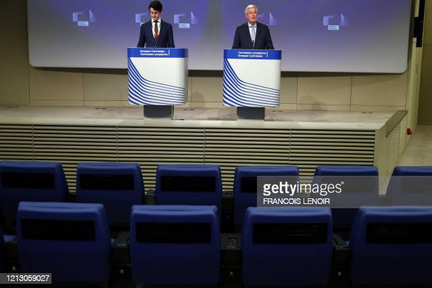 Empty seats are seen in the first two rows as European Union's Brexit negotiator Michel Barnier speaks during a news conference following the third...