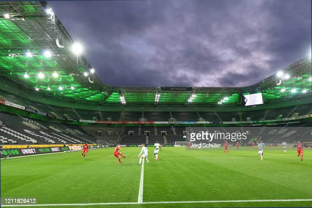 Empty seats are seen inside the stadium during the Bundesliga match between Borussia Moenchengladbach and 1 FC Koeln at BorussiaPark on March 11 2020...
