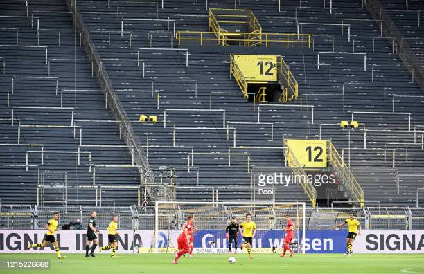 Empty seats are seen inside the stadium during the Bundesliga match between Borussia Dortmund and FC Bayern Muenchen at Signal Iduna Park on May 26,...