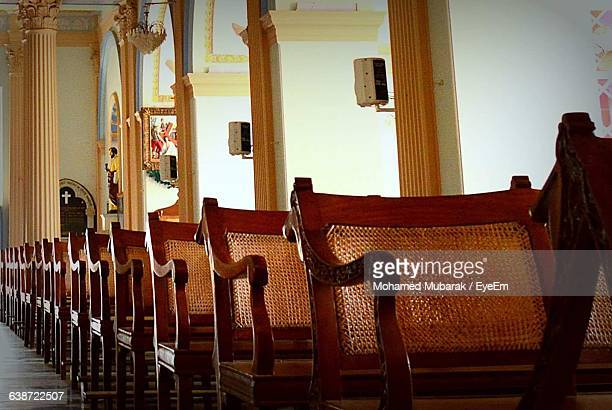 Empty Seats Arranged In Row At Church