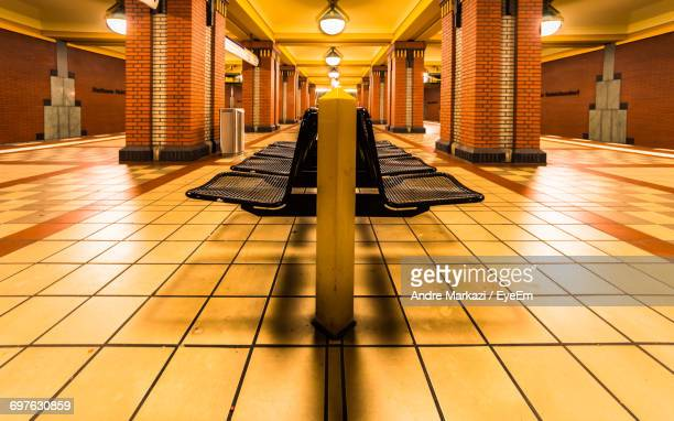Empty Seats At Illuminated Subway Station