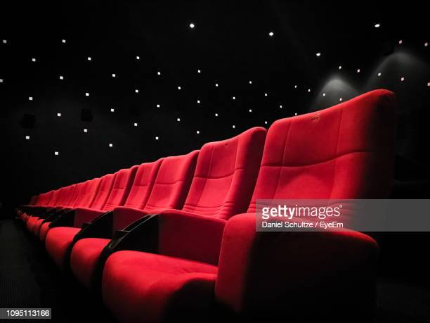 empty seats at movie theater - seat stock pictures, royalty-free photos & images