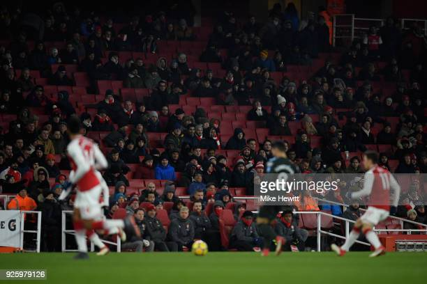 Empty seats behind the Arsenal bench during the Premier League match between Arsenal and Manchester City at Emirates Stadium on March 1 2018 in...
