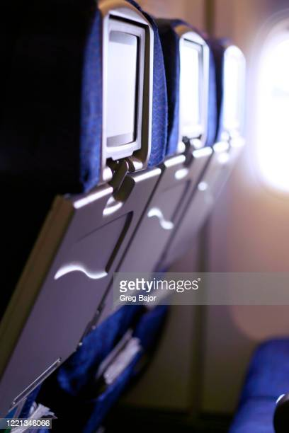 empty seats in aeroplane - greg bajor stock pictures, royalty-free photos & images