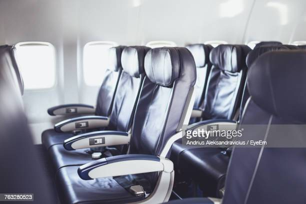 empty seats in airplane - vehicle seat stock pictures, royalty-free photos & images