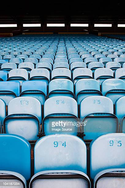 empty seats in football stadium - empty bleachers stock photos and pictures