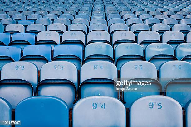 empty seats in football stadium - empty bleachers stockfoto's en -beelden