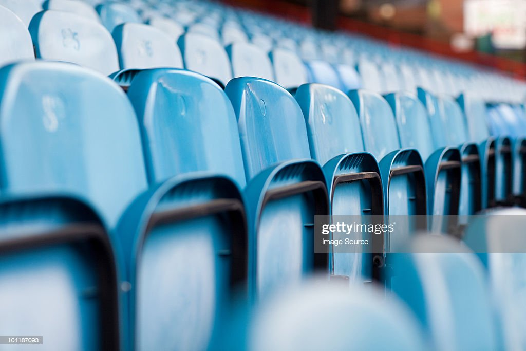 Empty seats in football stadium : Stock Photo