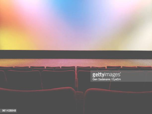 empty seats in movie theater against projection screen - film festival stock pictures, royalty-free photos & images