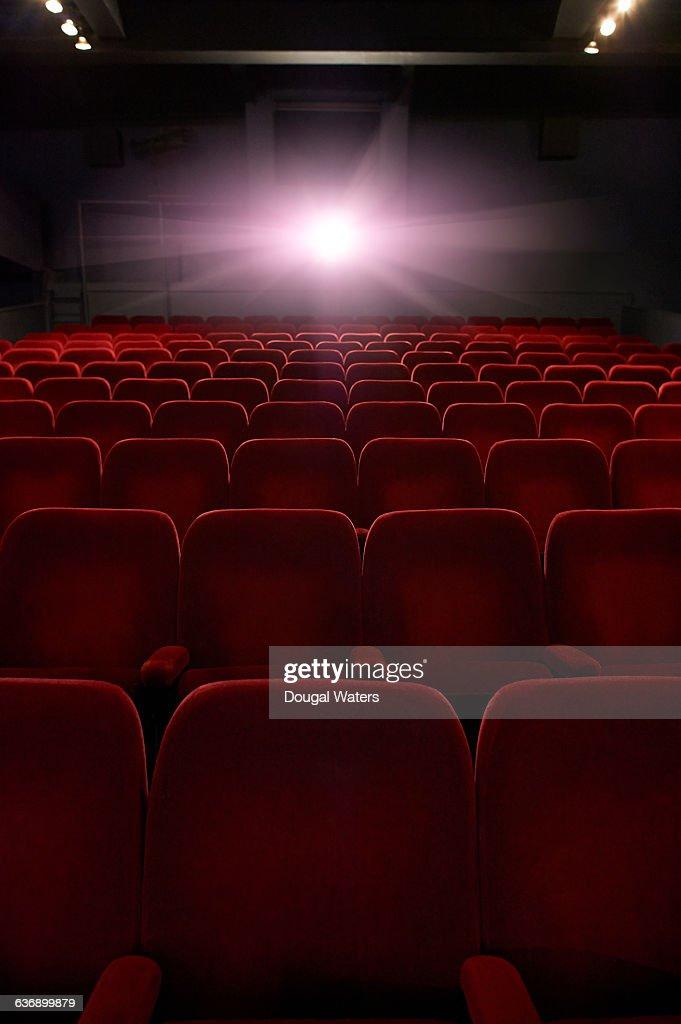 Empty seats in movie theatre. : Stock Photo