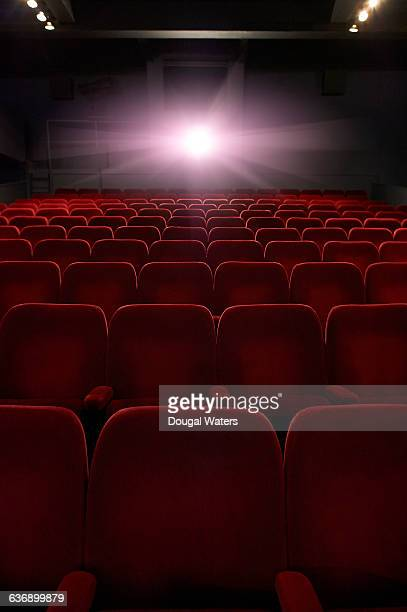 empty seats in movie theatre. - spotlight film stock photos and pictures