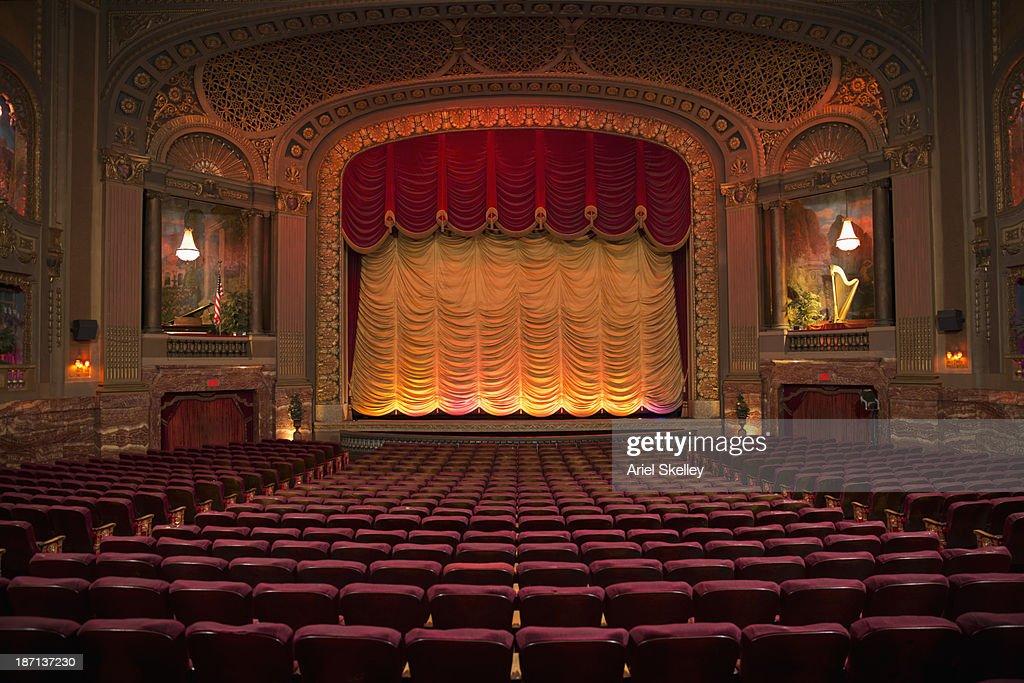 Empty seats in ornate movie theater : Foto stock